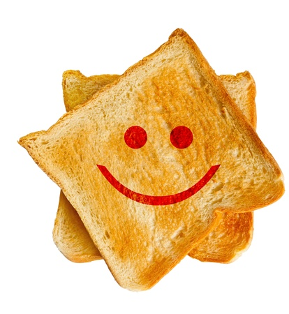Red smile face on bread slice toasts, happy face photo