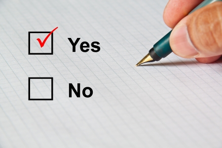 Select Yes in paper choices by classic pen Stock Photo