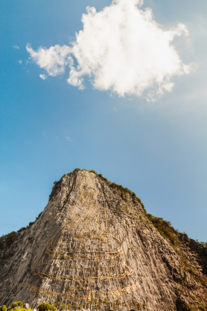 chonburi: Carved buddha image on the cliff at Khao Chee Jan,  Thailand Stock Photo