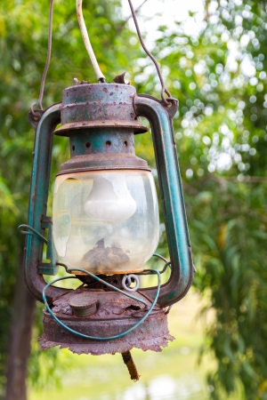 Rusty vintage and very old lantern with electric lamp photo
