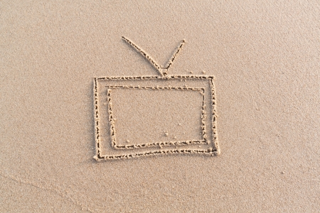 Writing television on the sand by hand