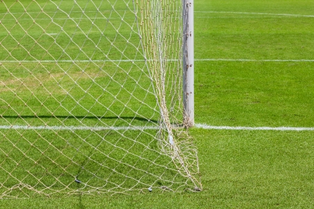 Behind pillar of goal of  football  soccer   field photo