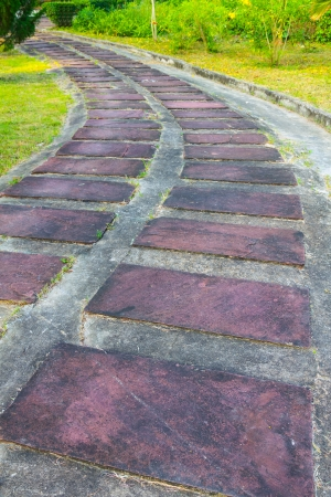Brown Stone and concrete path in park Stock Photo