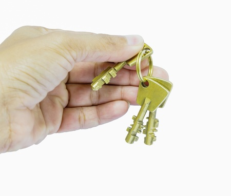 Holding three brass keys by hand, safety concept  Stock Photo - 16398107