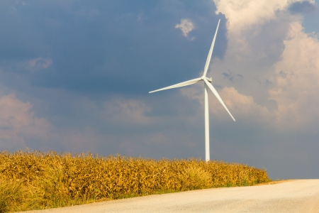 Wind turbine on wind field with cloudy sky Stock Photo - 16607897