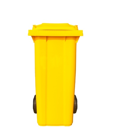 Big yellow garbage bin or trash can with black wheels photo