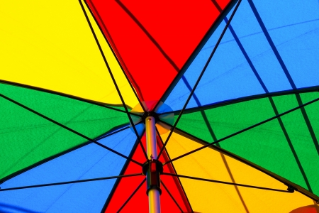Under of colorful umbrella in sunny day