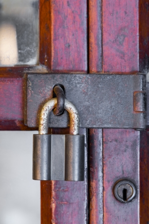 Rusty master key on old wood door photo