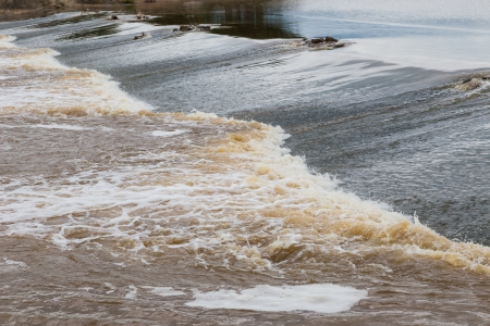 Water flowing from weir in rainy season Stock Photo