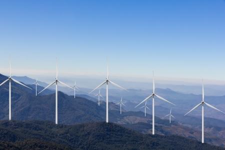 Wind turbine farm on mountain photo