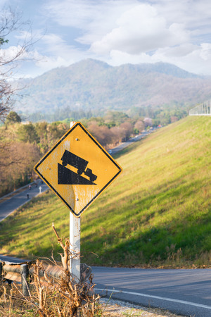 Steep road traffic sign for road on hill and mountain photo