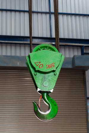 Green crane hook in factory photo