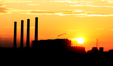 Orange sunset and cloud over gas turbine  electrical power plant photo