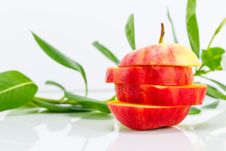 sliced apple: Sliced apple with flower plant