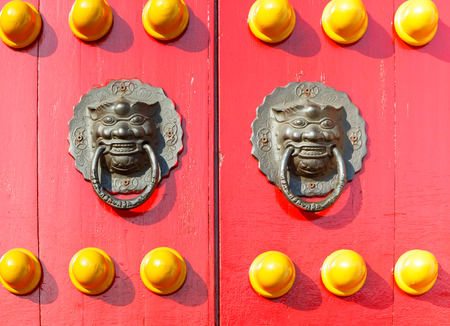 Old Chinese red door with metal knocker