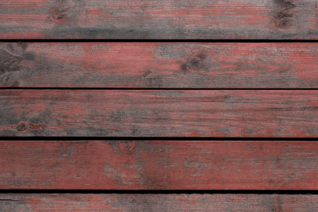 Old red wooden board for background