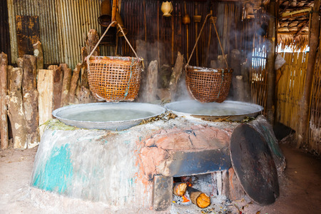 log basket: Traditional salt making by boiled with old method in Nan Thailand