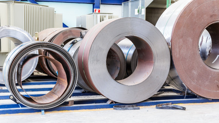 Cold rolled steel coils waiting before feeding to machine in metalwork manufacturing