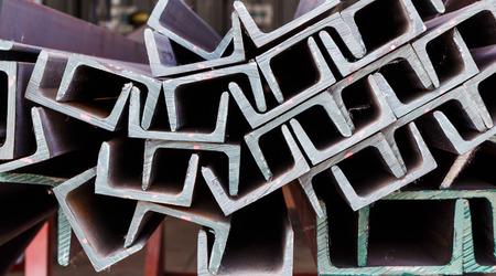 Close up heap of U shape beam steel in factory shelf Stock Photo