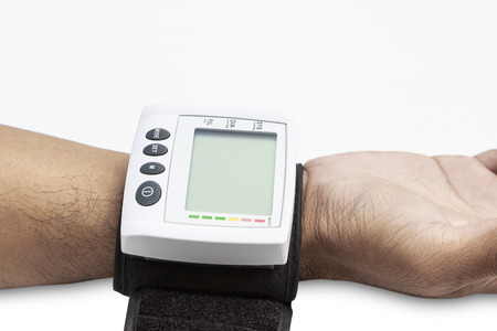 Blood pressure on patient wrist with white background