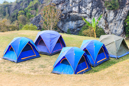 Dome tents in camping site on mountain