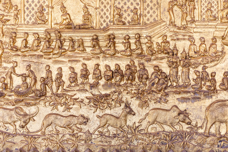 asian culture: Sculpture wall of asian culture in luangprabang , Laos
