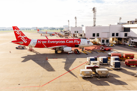 BANGKOK, THAILAND - 12 SEPTEMBER 2015 - Airbus A320-200 Thai Airasia connected to jetway at Don Muang international airport. Thai Airasia is the low cost airline in Thailand.