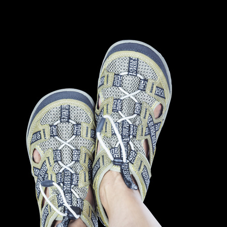 moccasin: Isolated feet on casual trekking footware with clipping path