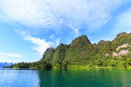 High mountain and blue sky over lagoon Reklamní fotografie