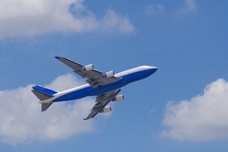 747 400: Boeing 747-400 airplane againt blue sky after take off