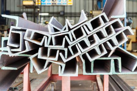 Close up heap of U shape beam steel in factory shelf Standard-Bild