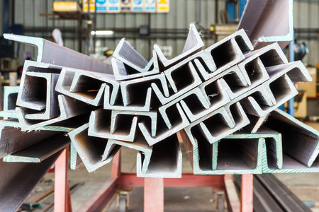 steel structure: Close up heap of U shape beam steel in factory shelf Stock Photo