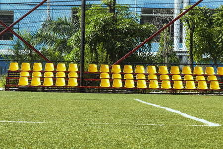 Row of yellow chairs in football stadium