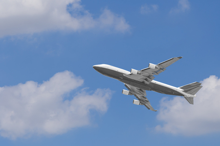 boeing: Boeing 747-400 airplane againt blue sky after take off