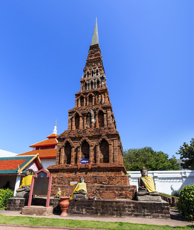 hariphunchai: Pagoda in Wat Phra That Hariphunchai at Lamphun north of Thailand  Thai text in blue plate is pagoda name Jadee-Patumwadee the other is prayer texts