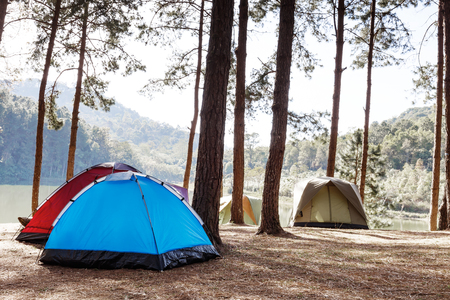 camping site: Tents of traveler in camping site near lake