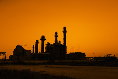 electric generating plant: Silhouette gas turbine electrical power plant at dusk