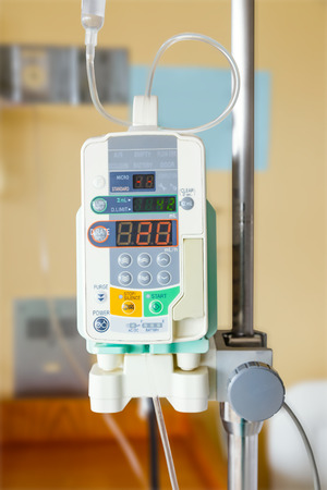 Automatic infusion pump of IV drop for patient Stock Photo