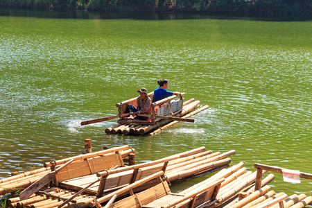 brigt: MAE HONG SON, THAILAND - FEBUARY 2: Traveler relaxing on bamboo raft in brigt lake of Pang Tong on Febuary 2, 2016 in Mae Hong Son, Thailand Editorial