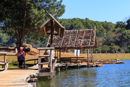MAE HONG SON, THAILAND - FEBUARY 2: Traveler relaxing on bamboo bridge and hut in lake of Pang Tong on Febuary 2, 2016 in Mae Hong Son, Thailand