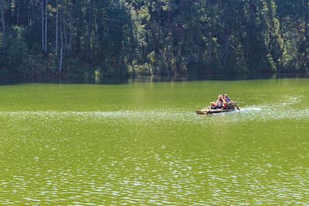 MAE HONG SON, THAILAND - FEBUARY 2: Traveler relaxing on bamboo raft in brigt lake of Pang Tong on Febuary 2, 2016 in Mae Hong Son, Thailand Editorial