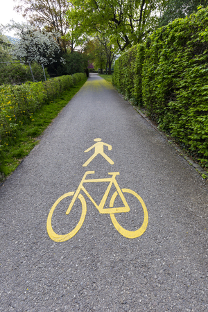 Human walk and bicycle sign on local road of exercise in the park 스톡 콘텐츠