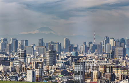 Building of Tokyo city with Tokyo tower and skyline of Fuji mountain in Japan from over view
