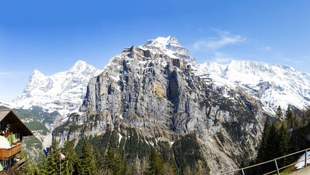 Schwarzmonch peak in Berner oberland looking from murren village with Eiger, Monch and Jungfraujoch on the back in panorama view