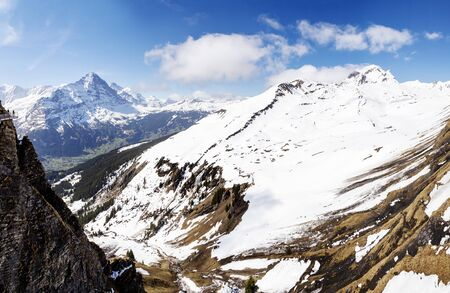 Snow on Alps mountain at Switzerland, looking from Sky cliff walk on First peak Grindelwald in panorama view
