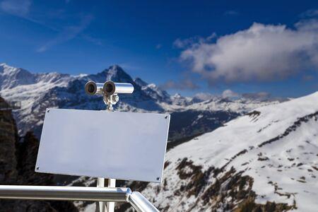 Binocular on First Cliff walk from First peak Grindelwald looking for Eigernordwand , Eiger norh face peak of Alps mountain Switzerland Europe