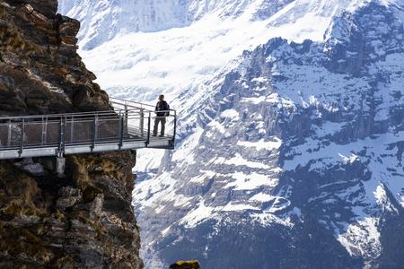GRINDELWALD BERNE, SWITZERLAND - APRIL 24, 2108 : Traveller are walking on sky cliff walk at First peak of Alps mountain Grindelwald Switzerland