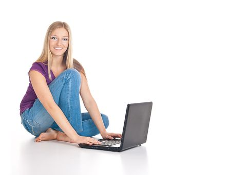 Woman sitting on the floor with laptop Stock Photo - 6682624