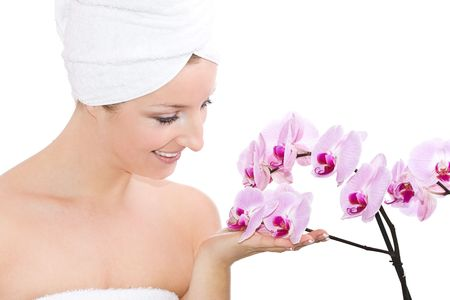 Woman with orchid flowers  photo