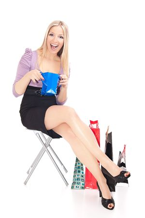 Caucasian sitting with gift bags Stock Photo - 6719808